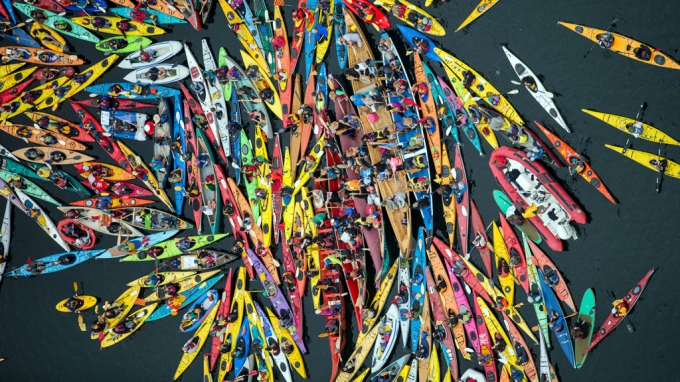 Activists participate in the sHell No Flotilla part of the Paddle In Seattle protest.  Nearly a thousand people from country gathered May 16, 2015 in Seattle's Elliot Bay for a family-friendly festival and on-land rally to protest against Shell's Arctic drilling plans.  Photo by Greenpeace