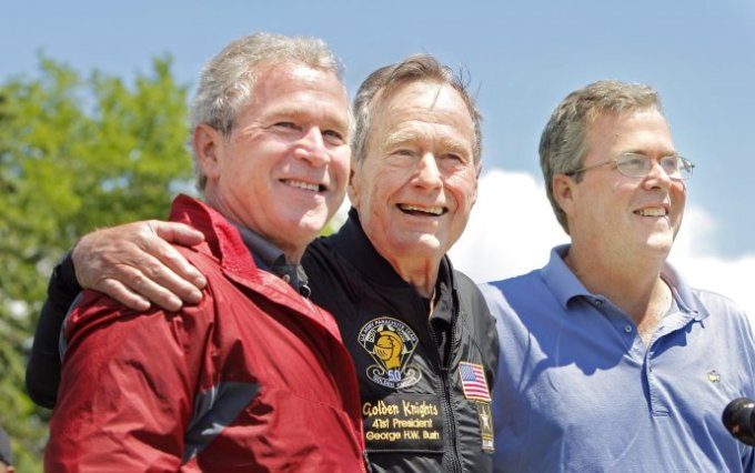 CORRECTION published Sunday, June 14, 2009: A photo cutline on Page A11 Saturday should have said former President George H. W. Bush poses with his sons former President George W. Bush and Jeb Bush. It was a photographer's error. -- Gregory Rec/Staff Photographer: -- George H.W. Bush is flanked by his sons George W. Bush and (Neil Bush)* after completing a parachute jump in Kennebunkport on Friday, June 12, 2009 for his 85th birthday. -- Correct id: JEB BUSH* (Photo by Gregory Rec/Portland Press Herald via Getty Images)