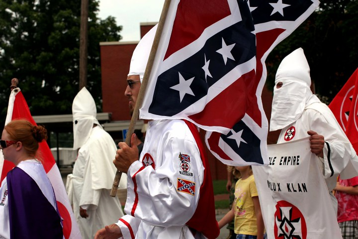 PULASKI, TN - JULY 11:  Members of the Fraternal White Knights of the Ku Klux Clan participate in the 11th Annual Nathan Bedford Forrest Birthday march July 11, 2009 in Pulaski, Tennessee. With a poor economy and the first African-American president in office, there has been a rise in extremist activity in many parts of America. According to the Southern Poverty Law Center in 2008 the number of hate groups rose to 926, up 4 percent from 2007, and 54 percent since 2000. Nathan Bedford Forrest was a lieutenant general in the Confederate Army during the American Civil War and played a role in the postwar establishment of the first Ku Klux Klan organization opposing the reconstruction era in the South.  (Photo by Spencer Platt/Getty Images)