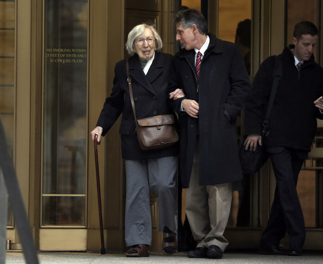 Miriam Moskowitz, 98, accompanied by her nephew Ira Moskowitz, leaves federal court in New York on Thursday, Dec. 4, 2014 after a judge rejected her request to erase her 1950 conviction for conspiracy to obstruct justice in the run-up to the atomic spying trial of Julius and Ethel Rosenberg. She served a two-year prison sentence. (AP Photo/Richard Drew)