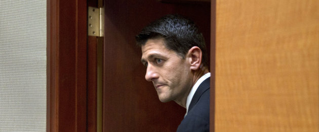 Rep. Paul Ryan, R- Wis., arrives at a news conference following a House Republican meeting, Tuesday, Oct. 20, 2015, on Capitol Hill in Washington. Ryan told GOP lawmakers that he will run for speaker, but only if they embrace him by week's end as their consensus candidate, an ambitious bid to impose unity on a disordered and divided House. (AP Photo/Andrew Harnik)