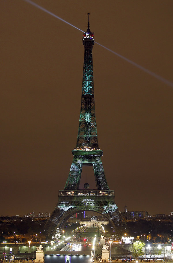 PARIS, FRANCE - NOVEMBER 29:  An artwork entitled 'One Heart One Tree' by artist Naziha Mestaoui is displayed on the Eiffel tower covered by a green visual forest, as part of the organisation of the Conference on Climate Change COP21 on November 29 in Paris, France. The climate change conference COP21 will gather 193 countries in Paris from November 30 to December 11, 2015.  (Photo by Chesnot/Getty Images)