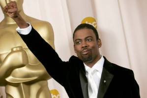 Academy Awards host Chris Rock poses for photographers backstage at the 77th Academy Awards Sunday, Feb. 27, 2005, in Los Angeles. (AP Photo/Laura Rauch)