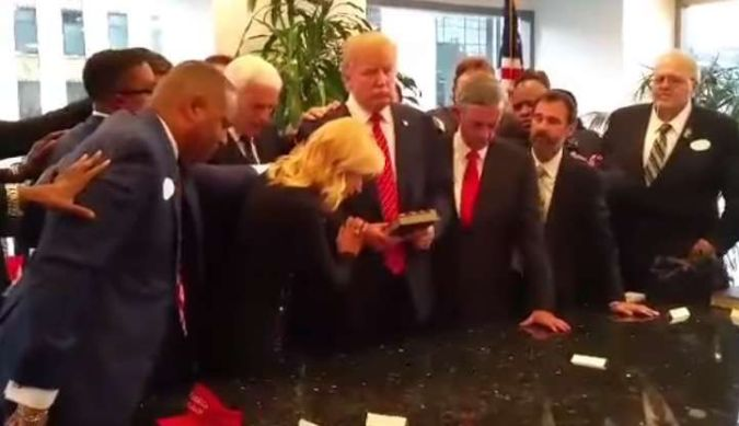 trump-laying-hands