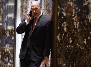 Goldman Sachs COO Gary Cohn talks on the phone as he waits for the start of a meeting with President-elect Donald Trump at Trump Tower, Tuesday, Nov. 29, 2016, in New York. (AP Photo/Evan Vucci)