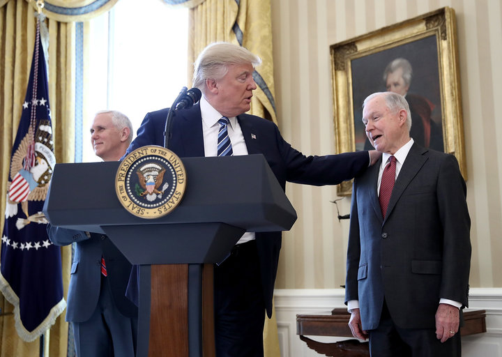WASHINGTON, DC - FEBRUARY 09:  U.S. President Donald Trump (C) put his hand on the shoulder of Sen. Jeff Sessions (R) after introducing him before Sessions's swearing in ceremony in the Oval Office of the White House February 9, 2017 in Washington, DC. Trump also signed three executive orders immediately after the swearing in ceremony. Also pictured is U.S. Vice President Mike Pence (L).  (Photo by Win McNamee/Getty Images)
